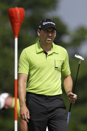 Sergio Garcia, of Spain, walks on the 18th green during practice for the U.S. Open golf tournament at Merion Golf Club, Tuesday, June 11, 2013, in Ardmore, Pa. (AP Photo/Gene J. Puskar)