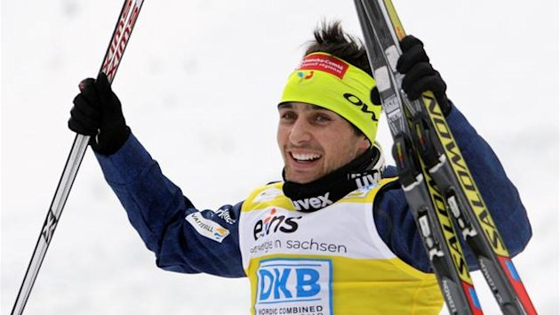France's Jason Lamy Chappuis celebrates after winning the LH Individual Gundersen 10 km race at the Nordic Combined World Cup in Klingenthal February 19, 2012
