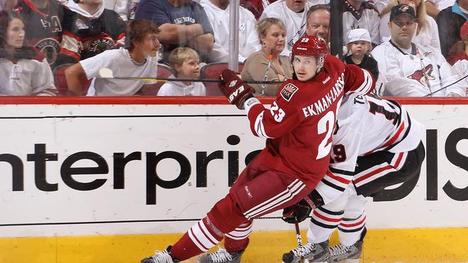 Oliver Ekman-Larsson #23 Of The Phoenix Coyotes Attempts To Play The Puck Past Jonathan Toews #19 Of The Chicago Getty Images
