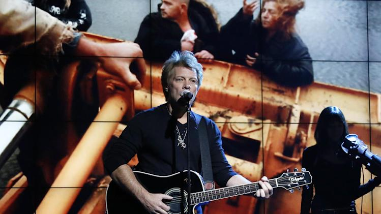 """FILE - In this Nov. 2, 2012, photo provided by NBC, Jon Bon Jovi performs in New York, during """"Hurricane Sandy: Coming Together,"""" a concert hosted by NBC to raise money for victims of Superstorm Sandy. Bon Jovi and Bruce Springsteen Springsteen are among the New Jersey natives joining a special fund created in the wake of Superstorm Sandy. The musicians will serve on the advisory board of the Hurricane Sandy New Jersey Relief Fund. The nonprofit was created by state first lady Mary Pat Christie to aid in the long-term recovery effort following the storm. The board has raised more than $16 million, so far. (AP Photo/NBC, Heidi Gutman, file)"""