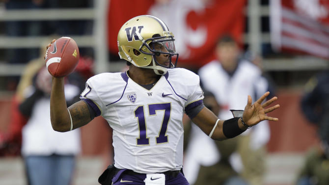 Washington quarterback Keith Price passes against Washington State in the first half of an NCAA college football game, Friday, Nov. 23, 2012, in Pullman, Wash. (AP Photo/Ted S. Warren)