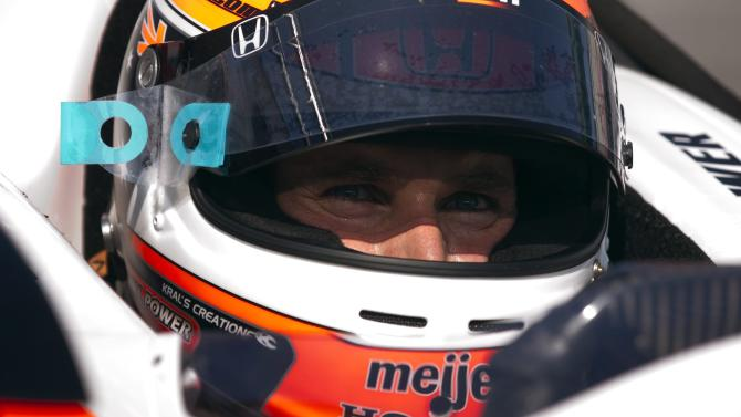 Will Power, of Australia, sits in his car in the pits in practice for the Toronto Indy auto race, Saturday, July 9, 2011, in Toronto. (AP Photo/The Canadian Press, Frank Gunn)
