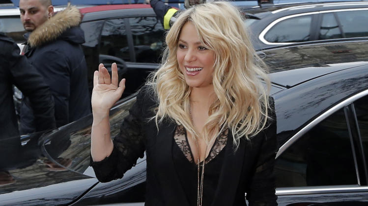 "FILE - In a March 27, 2013 file photo, Colombian singer Shakira arrives for a promotion event on the Champs Elysee Avenue in Paris. The singer and judge on ""The Voice"" is asking a New York judge to throw out a $250 million lawsuit filed by her ex, Antonio de La Rua. De la Rua is the son of former Argentine President Fernando de la Rua. He dated Shakira for more than a decade before they split in 2011. (AP Photo/Francois Mori, File)"