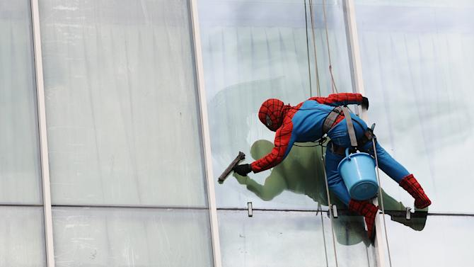Indonesian Window Cleaner At Work In Spider-Man Uniform