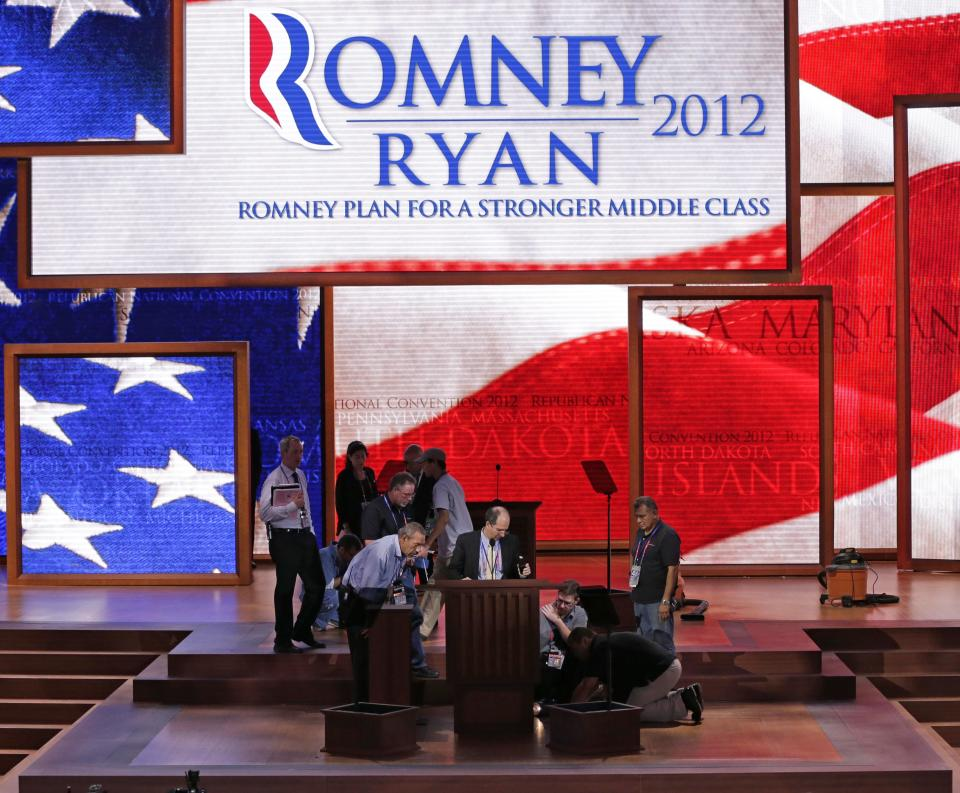 Stagehands make final adjustments to the expanded stage where Republican presidential nominee Mitt Romney will accept his party's nomination later tonight a the Republican National Convention in Tampa, Fla., on Thursday, Aug. 30, 2012. (AP Photo/J. Scott Applewhite)
