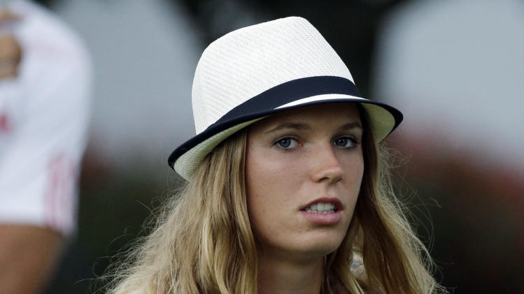 Tennis player Caroline Wozniacki leaves after watching Rory McIlroy, of Northern Ireland, during the first round of the Masters golf tournament Thursday, April 11, 2013, in Augusta, Ga. (AP Photo/David Goldman)