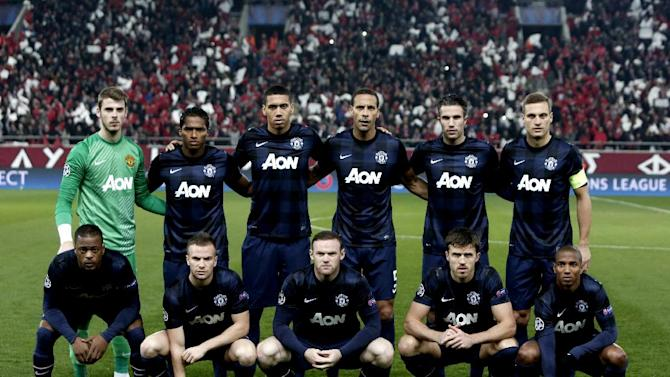 Manchester United's players pose before their Champions League match against Olympiakos at the Karaiskaki Stadium in Athens, on February 25, 2014