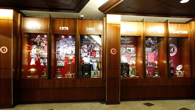 This Dec. 21, 2012, photo shows Alabama's trophy cases at the Mal M. Moore Athletic Facility in Tuscaloosa, Ala. (AP Photo/Butch Dill)