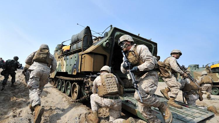 US Marines get out from an amphibious assault vehicle during a joint military exercise with their South Korean counterparts at Pohang, on March 31, 2014