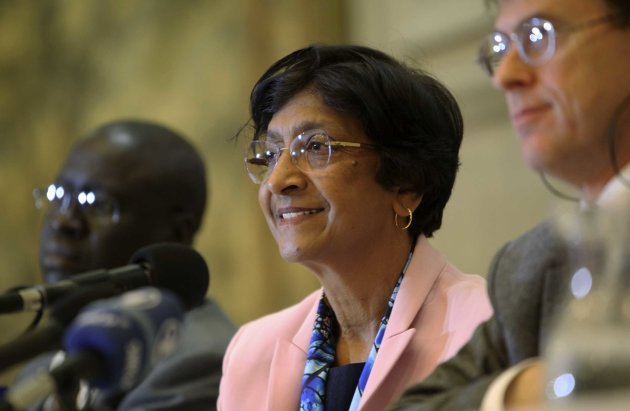 United Nations High Commissioner for Human Rights Navi Pillay, center, addresses a press conference in Harare, Friday, May, 25, 2012. U.N. Human Rights Commissioner Navi Pillay said Friday they were discouraging foreign investment and having other unintended consequences that are hurting the poorest and most vulnerable Zimbabweans. (AP Photo/Tsvangirayi Mukwazhi)