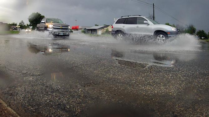 Vehicles drive along wet conditions on Thursday, May 8, 2014 in Wichita Falls, Texas. North Texans woke up Thursday morning to the welcome sound of rain and a little thunder as a storm system moved across the area dropping approximately one-half inch of rain overnight and in the morning in Wichita Falls, Texas. The area is suffering from exceptional drought conditions. (AP Photo/Wichita Falls Times Record News, Torin Halsey)