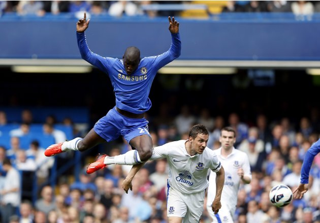 Chelsea's Demba Ba challenges Everton's Jagielka during their English Premier League soccer match in London