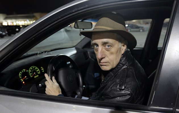 Michael Choate sits in his vehicle Thursday, Feb. 21, 2013, in West Jordan, Utah. Choate, a now-retired aircraft logistics specialist at Hill Air Force Base, said he nearly lost his security clearance and job. Steed stopped him because he was wearing a Halloween costume and booked him even though three breathalyzers tests showed no alcohol in his system. Choate said he spent $3,800 and had to take four days off of work to get his DUI charged dismissed. (AP Photo/Rick Bowmer)