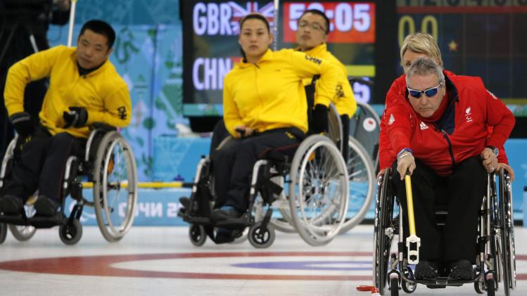 Britain's Gault delivers a stone during the bronze medal wheelchair curling match against China at the 2014 Sochi Paralympic Winter Games