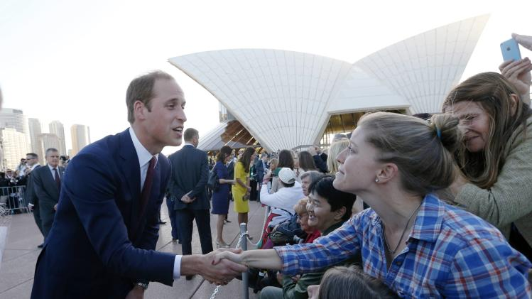 Britain's Prince William greets a well-wisher following a reception at the Sydney Opera House