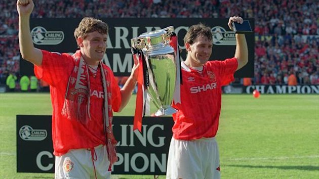 Steve Bruce and Bryan Robson celebrate winning the Premier League title in 1994 (PA)