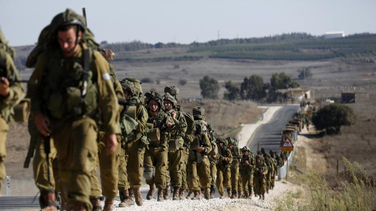 Israeli soldiers from the paratroopers brigade take part in a drill in the Israeli-occupied Golan Heights, near the border with Syria