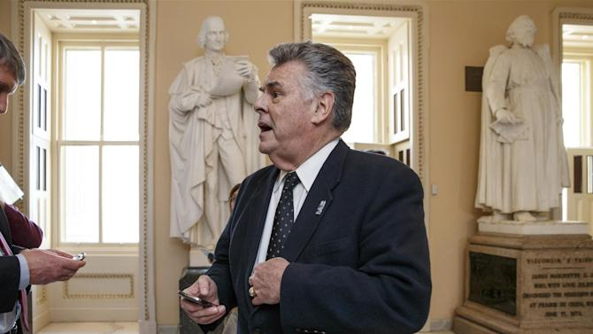 """In this Feb. 27, 2015, photo, Rep. Peter King, R-N.Y., stands outside the House chamber holds a procedural votes on a spending bill for the Homeland Security Department at the Capitol in Washington, Friday, Feb. 27, 2015. Democrats didn't get all they wanted in Congress' struggle over Homeland Security, but many feel they are winning a broader political war that will haunt Republicans in 2016 and beyond. King said his party's wounds are self-inflicted. """"Politically it's going to kill us,"""" he said of conservatives' demands to link Homeland Security funding with Obama's immigration policy. """"Morally, you're equating an immigration order with the lives of American citizens.""""  (AP Photo/J. Scott Applewhite)"""