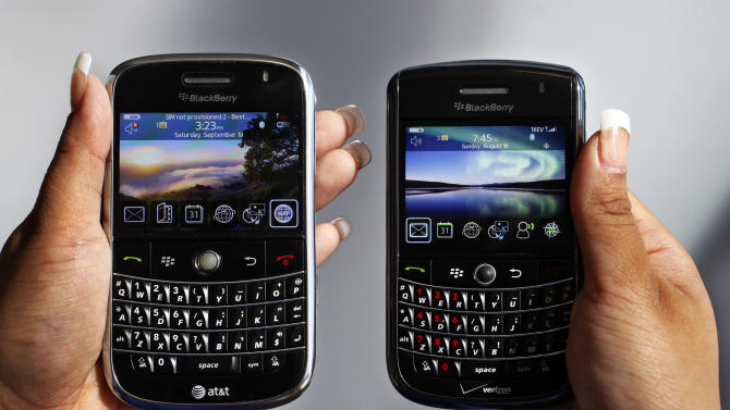 """In this Monday, Sept. 21, 2009, file photo, a BlackBerry Bold, left, and Tour, right are photographed in Mountain View, Calif., Monday, Sept. 21, 2009.Troubled smartphone maker BlackBerry has won an early round in its legal battle against an iPhone keyboard made by a startup co-founded by """"American Idol"""" host Ryan Seacrest. (AP Photo/Paul Sakuma, File)"""