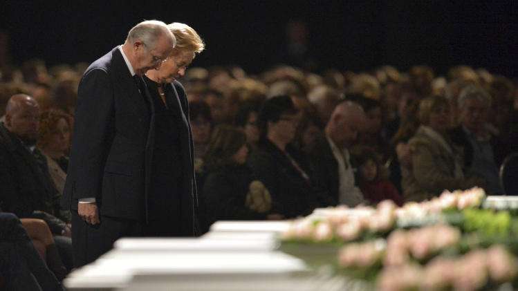 Belgium's King Albert II, left, and Queen Paola participate in a memorial service at the Soeverein Arena in Lommel, Belgium on Wednesday, March 21, 2012. Mourners and family members attended a memorial service to honor the victims of a bus crash in the Swiss Alps which killed 22 children and six adults . (AP Photo/Yorick Jansens, Pool)