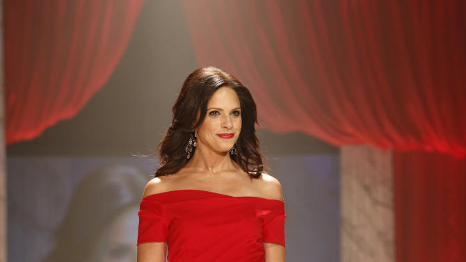 Soledad O'Brien walks the runway at the Red Dress Collection 2013 Fashion Show, on Wednesday, Feb. 6, 2013 in New York. (Photo by John Minchillo/Invision/AP)