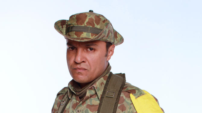 "FILE - In this 2012 promotional file photo provided by RCN Television, actor Julian Roman poses in character as Carlos Castano for the television series ""Tres Caines,"" or ""Three Cains,"" an allusion to the Biblical story of Cain slaying his brother Abel, in Bogota, Colombia.  The soap opera has stirred unprecedented controversy by dramatizing _ and some say romanticizing _ the career of the Castano brothers, central figures in the creation of the country's murderous far-right militias. (AP Photo/RCN Television, File)"
