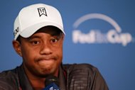 Tiger Woods answers questions after finishing 7-under during the first round of the Deutsche Bank Championship at TPC Boston on August 31, 2012 in Norton, Massachusetts. Woods ended the day sharing third place alongside Ryan Moore