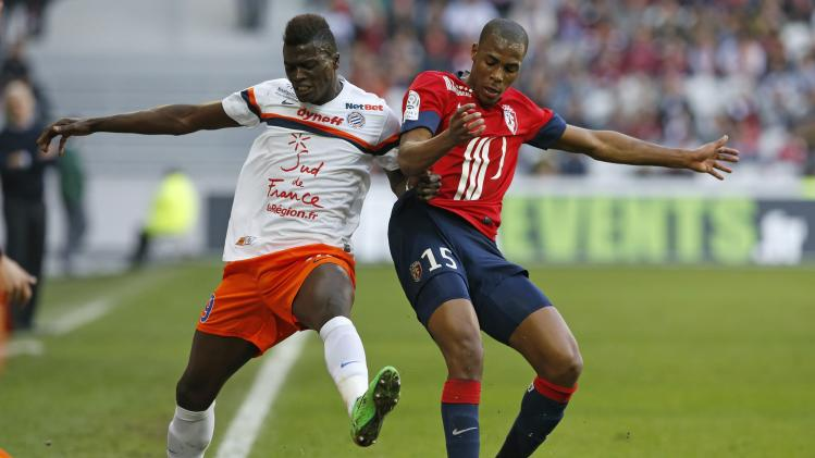 Lille's Sibide fights for the ball with Montpellier's Niang during their French Ligue 1 soccer match in Villeneuve d'Ascq