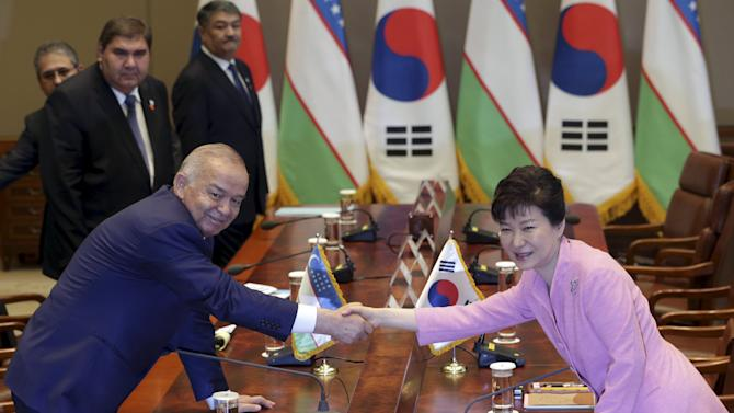 Uzbek President Islam Karimov shakes hands with South Korean President Park Geun-hye before their meeting at the presidential Blue House in Seoul