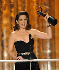 Tina Fey accepts the award for outstanding female actor in a comedy series for 30 Rock at the 19th Annual Screen Actors Guild Awards at the Shrine Auditorium in Los Angeles on Sunday Jan. 27, 2013. (Photo by John Shearer/Invision/AP)
