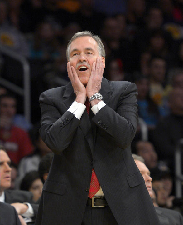 Los Angeles Lakers head coach Mike D'Antoni reacts to a foul fall during the second half of an NBA basketball game against the Cleveland Cavaliers, Tuesday, Jan. 14, 2014, in Los Angeles
