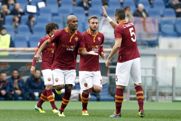 AS Roma's Maicon celebrates with teammates after scoring against Fiorentina during their Italian Serie A soccer match at the Olympic stadium in Rome