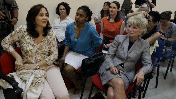 Mariela Castro, director of the Cuban National Center for Sex Education and daughter of Cuba's President Raul Castro, left, meets with a U.S. women's delegation in Havana, Cuba, Monday, June 6, 2011. A group of U.S. women leaders traveled to Havana for an exchange of ideas on topics including gender, reproductive health and gay rights. The trip was organized by the Center for Democracy in the Americas, which studies U.S. policy toward countries in the region. (AP Photo/Javier Galeano)