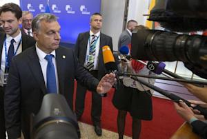 Hungarian Prime Minister Victor Orban answers reporters'…