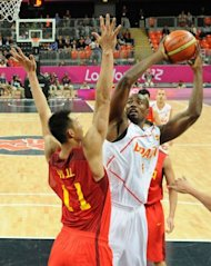 Spanish centre Serge Ibaka (R) is challenged by Chinese centre Yi Jianlian during the Men&#39;s Preliminary Round Group B match Spain vs China at the London 2012 Olympic Games. Four years after China put an over-time scare into Spain&#39;s NBA-laden silver medal Olympic squad, Los Angeles Lakers star Pau Gasol and his Spanish teammates made certain it would not happen again
