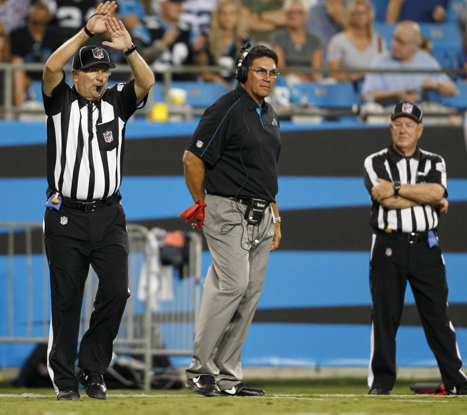 Carolina Panthers head coach Ron Rivera, center, watches from the sidelines during the first half of an NFL preseason football game against the Houston Texans in Charlotte, N.C., Saturday, Aug. 11, 2012. (AP Photo/Bob Leverone)