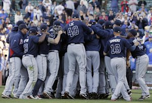 Atlanta Braves players and coaches celebrate after…
