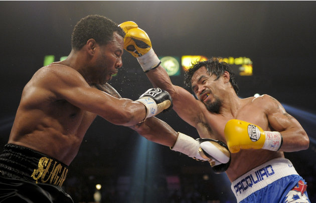 Shane Mosley, left, and Manny Pacquiao exchange punches in the sixth round during a WBO welterweight title bout, Saturday, May 7, 2011, in Las Vegas.  (AP Photo/Isaac Brekken)