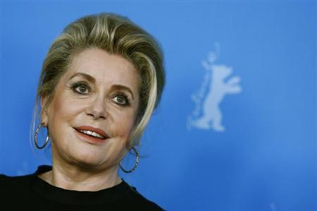 "Cast member Deneuve poses during a photocall to promote the movie ""Dans La Cour"" at Berlinale International Film Festival in Berlin"