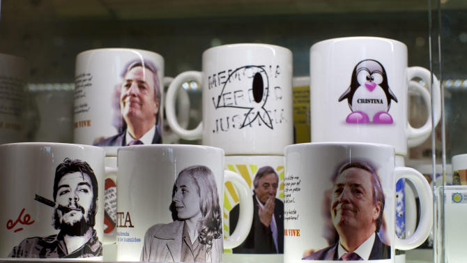 "Mugs with with images of the late revolutionary hero Ernesto 'Che' Guevara, left, the late Evita Peron, second from left, and late President Nestor Kirchner sit for sale in the shop of the Bicentennial Museum in Buenos Aires, Argentina, Wednesday, Nov. 21, 2012.  A documentary film titled ""Nestor Kirchner"" hits the theaters on Thursday, the latest example of an ongoing effort to exalt the late president's memory, seeking to match the level of Juan Domingo Peron.  Streets, hospitals, tunnels and even a soccer tournament is named after Nestor Kirchner, who served as president from 2003 to 2007 and died at the age of 60 on Oct. 27, 2010. (AP Photo/Natacha Pisarenko)"