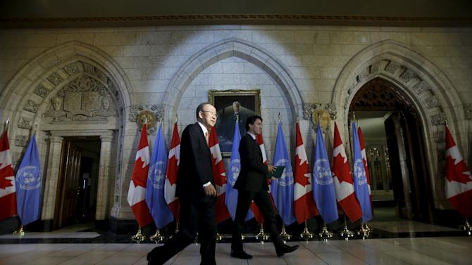 Canada's PM Trudeau and UN Secretary-General Ban Ki-moon arrive a news conference on Parliament Hill in Ottawa
