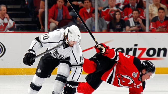 Zach Parise #9 Of The New Jersey Devils Falls Getty Images