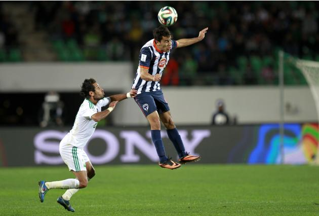 Adil Karrouchy of Morocco's Raja Casablanca fights for the ball with Gerardo Moreno of Mexico's Monterrey during their FIFA Club World Cup soccer match in Agadir