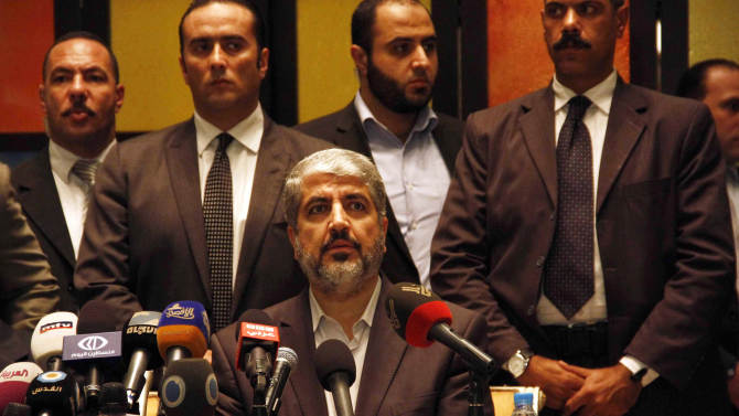 Hamas leader Khaled Mashaal speaks during a press conference in Cairo, Egypt, Wednesday, Nov. 21, 2012 after a cease-fire between Hamas and Israel. Israel and the Hamas militant group agreed to a cease-fire Wednesday to end eight days of the fiercest fighting in nearly four years, promising to halt air strikes and rocket attacks that have killed scores and to discuss easing an Israeli blockade constricting the Gaza Strip. Mashaal said the deal included an agreement to open all border crossings with the Gaza Strip, including the important Rafah crossing with Egypt. A copy of the deal obtained by The Associated Press appeared to be somewhat vague about the details on the crossings. (AP Photo/Ahmed Abd el Fatah)