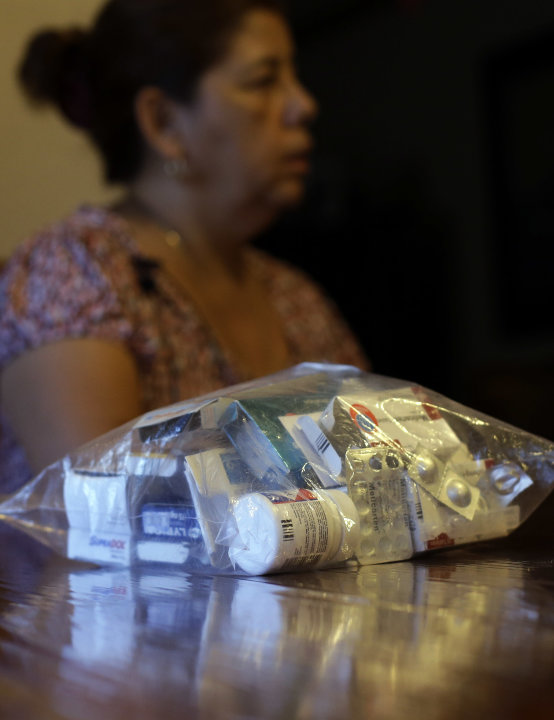Alma Fuentes, a legal immigrant, sits next to her bag of medications as she talks about a recent stroke and her health care issues, Thursday, Sept. 6, 2012, in Los Fresnos, Texas. (AP Photo/Eric Gay)