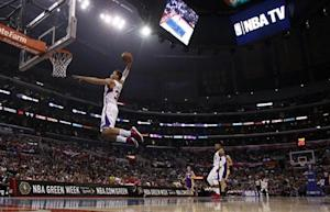 Clippers forward Griffin leaps for a dunk against the Lakers during first half NBA game in Los Angeles