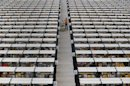 A worker collects orders at Amazon's fulfilment centre in Rugeley, central England