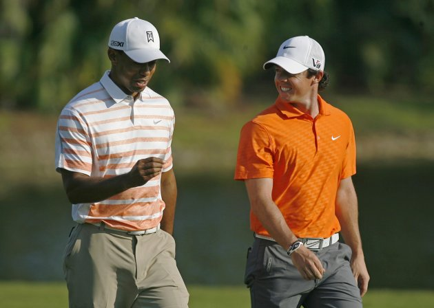 Tiger Woods and his playing partner, Northern Ireland's Rory McIlroy walk on the 14th fairway during second round play in the 2013 WGC-Cadillac Championship PGA golf tournament in Doral