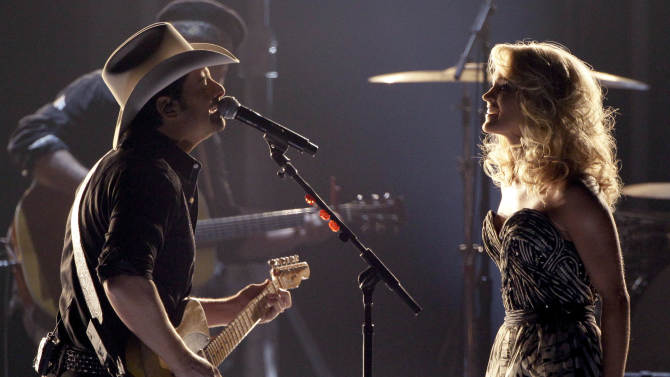 """Carrie Underwood, right, and Brad Paisley perform """"Remind Me"""" during the 45th Annual CMA Awards in Nashville, Tenn., on Wednesday, Nov. 9, 2011. (AP Photo/Mark Humphrey)"""