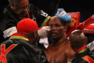 Bernard Hopkins is tended to in his corner by his team in between rounds against Chad Dawson during their WBC & Ring Magazine Light Heavyweight Title fight on April 28